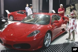 If you drive a friend's red sports car, like this Ferrari, please be careful. (AP Photo)