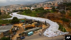 FILE -- Garbage bags line a street in Jdeideh, east Beirut, Lebanon, March 3, 2016. The Lebanese government has announced a temporary solution for the country's eight-month trash crisis, saying three landfills will be opened.