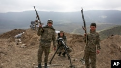 Armenian soldiers pose near a frontline in Nagorno-Karabakh, Azerbaijan. (April 6, 2016.)