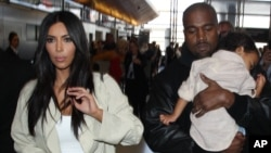 Kim Kardashian along with Kanye West and their daughter North are spotted at LAX Airport in Los Angeles, Ca, April 8, 2015.