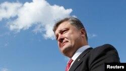 Ông Poroshenko nói những cuộc thảo luận sẽ diễn ra bên lề một hội nghị thượng đỉnh Á - Âu tại Milan.