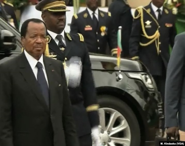FILE - Cameroon President Paul Biya arrives at the Boulevard for National Day celebrations, in the Yaounde, Cameroon, May 20, 2018.