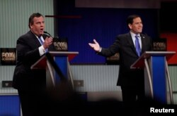 Republican U.S. presidential candidate Governor Chris Christie, left, and Senator Marco Rubio speak simultaneously during the Fox Business Network Republican presidential candidates debate in North Charleston, S.C., Jan. 14, 2016.