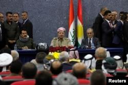 Iraqi Kurdish President Masoud Barzani sits with Kirkuk Governor Najmaldin Karim (R) during his visit in Kirkuk, Iraq, Sept. 12, 2017.