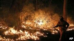 Các đám cháy rừng đã thiêu rụi 47.000 hectare đất và phá hủy nhiều nhà cửa.
