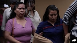 Evelyn Beatriz Hernandez, right, leaves the court accompanied by family during her second trial, in Ciudad Delgado on the outskirts of San Salvador, El Salvador, July 15, 2019.
