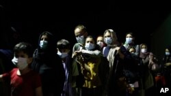 Evacuated citizens from Afghanistan arrive at Tirana International Airport in Tirana, Albania, Aug. 27, 2021.