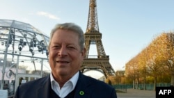 Former US vice president, politician, environmentalist and Nobel Peace Prize winner Al Gore is pictured within an interview with AFP on November 13, 2015 at the foot of the Eiffel Tower in Paris, ahead of the key United nations conference on climate change scheduled in Paris through November 30 - December 11.