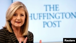 FILE - Arianna Huffington, president and Editor-in-Chief of The Huffington Post Media Group attends a session at the World Economic Forum (WEF) in Davos, Jan. 25, 2014.