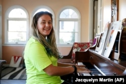Grace Brown, 14, poses for a portrait by the piano at her home in Alexandria, Va., Friday, Nov. 1, 2019.