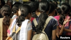 Women stand at a crowded place in the southern Indian city of Bangalore, Oct. 9, 2006. Safety is the biggest concern for women using public and private transport, according to a survey Thursday.