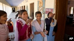 Girls take deworming pills in their school in Neemrana, 123 kilometers (76.8 miles) from New Delhi, in the Indian state of Rajasthan, Feb. 10, 2016. Millions of Indian children are taking part in a massive national deworming campaign to prevent parasitic worms from infecting their bodies and impairing their mental and physical development.