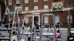 Ladders pile up as journalists prepare at the entrance to the Lindo Wing at St Mary's Hospital in London, July 2, 2013.