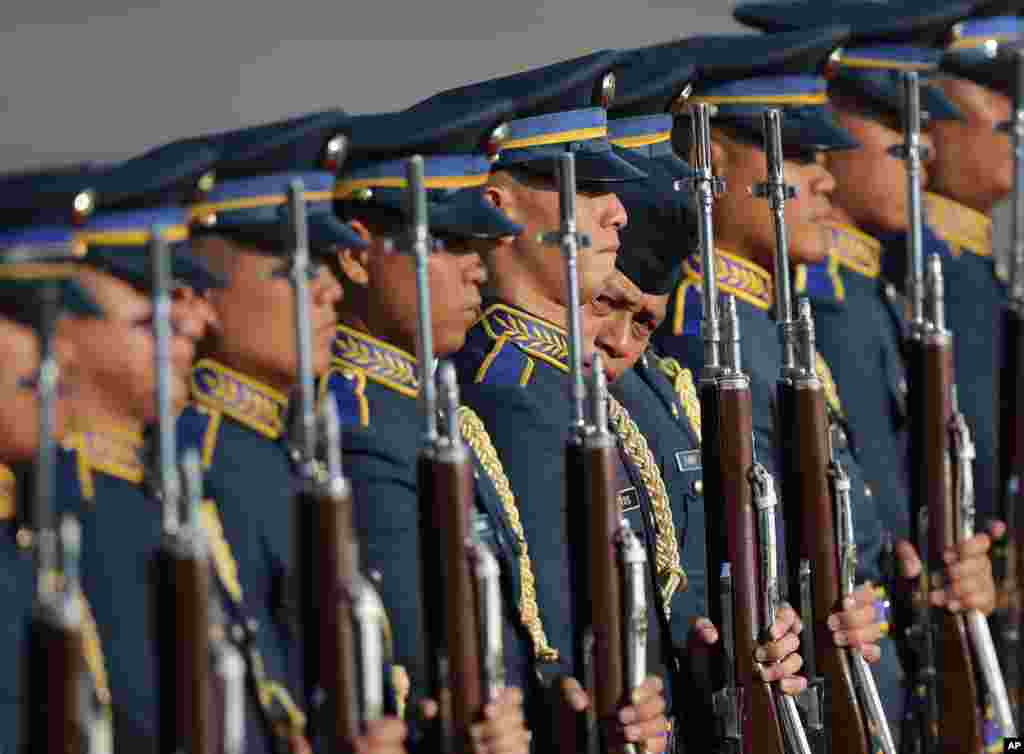 A Filipino trooper inspects the alignment of a guard of honor during rehearsals for the arrival of Indonesian President Joko Widodo at the Villamor Air Base in suburban Pasay, south of Manila, the Philippines.