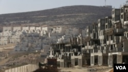 ບ່ອນສ້າງເຮືອນຊານຂອງ ຊາວຢິວ ທີ່ຕັ້ງຖິ່ນຖານຢູ່ໃນເຂດ ຢຶດຄອງທາງຝັ່ງຕາເວັນຕົກຂອງແມ່ນໍ້າຈໍແດນຫຼື West Bank.