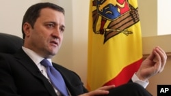 FILE - Moldova's Prime Minister Vlad Filat speaks during an interview with The Associated Press at the Moldovan embassy in Brussels, Belgium, March 27, 2012.
