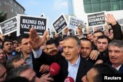 FILE - Zaman editor-in-chief Ekrem Dumanli, in foreground, the newspaper in Istanbul, Dec. 14, 2014.