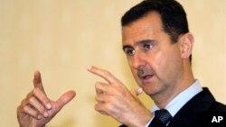 FILE - Syrian President Bashar Assad