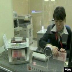 Ameerika podcjenjenu kinesku valutu okrivljuje za trgovinski debalans