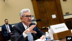 FILE - Federal Reserve Board Chairman Jerome Powell testifies during a House subcommittee hearing on Capitol Hill in Washington, June 22, 2021.