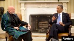 افغان ولسمشر حامد کرزي د طالبانو د دفتر پرانیستو وروسته د امریکا سره په امنیتي تړون خبرې وځنډولې