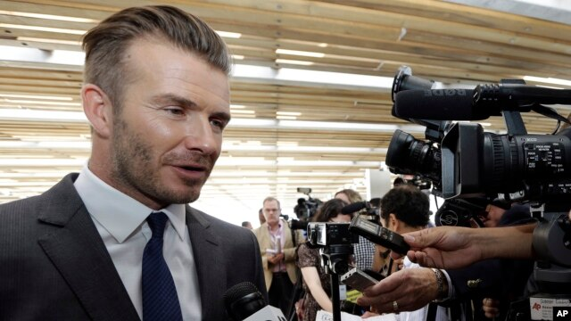 David Beckham responds to a question following a news conference where he announced he will exercise his option to purchase a Major League Soccer expansion team in Miami, Feb. 5,  2014, in Miami.