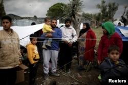 Moria kampında bir Suriyeli mülteci aile