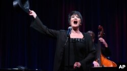 "FILE - Chita Rivera performs during the ""Chita Rivera: A Lot of Livin' to Do"" segment of the PBS 2015 Summer TCA Tour held at the Beverly Hilton Hotel in Beverly Hills, California, Aug. 2, 2015."