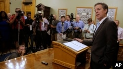 Kansas Gov. Sam Brownback, right, talks to reporters Thursday, July 27, in Topeka, Kansas. President Donald Trump nominated Brownback to be ambassador-at-large for international religious freedom. (AP Photo/Charlie Riedel)