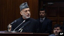 FILE - Afghan President Hamid Karzai is shown during his final address to parliament in Kabul, March 15, 2014.
