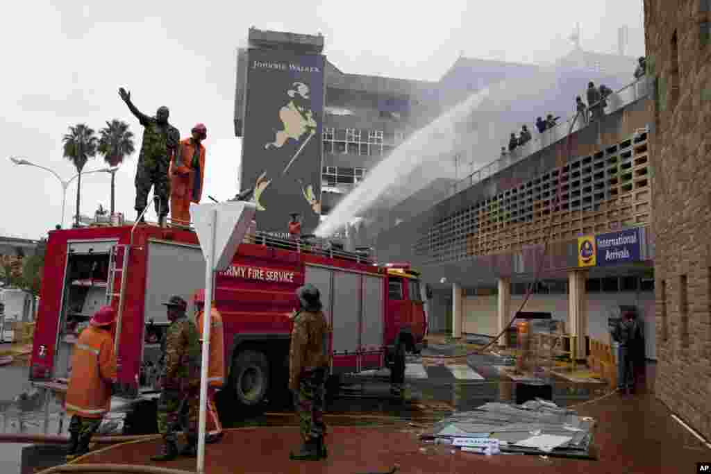 Firefighters put out the fire at the Jomo Kenyatta International Airport, Nairobi, August 7, 2013.