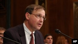 """FILE - """"Too many young people are ruining their lives and damaging their bodies from steroid use,"""" acting DEA Administrator Chuck Rosenberg says.."""
