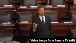 In this image from Senate video, Sen. Rand Paul, R-Ky., and a Republican presidential contender, speaks on the floor of the U.S. Senate Wednesday afternoon, May 20, 2015, at the Capitol in Washington, during a long speech opposing renewal of the Patriot A