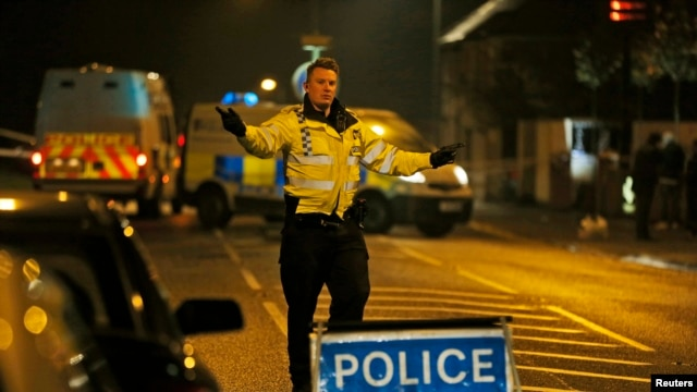 British police officers cordon off a road near a residence in Ascot, a town 40 kilometers west of London, Saturday, Mar. 23, 2013.