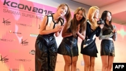 "K-Pop group SISTAR members attend a press conference prior to attending the K-Pop stage, ""M Countdown"" at the KCON 2015 Japan in the Saitama Super Arena in Saitama, April 22, 2015."