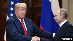 U.S. President Donald Trump and Russia's President Vladimir Putin shake hands after their joint news conference in the Presidential Palace in Helsinki, Finland, July 16, 2018.