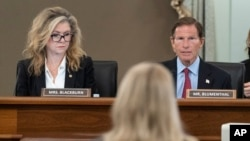 Sen. Marsha Blackburn, R-Tenn., left, and Sen. Richard Blumenthal, D-Conn., right speak to former Facebook data scientist Frances Haugen, center, during a hearing of the Senate Commerce, Science, and Transportation Subcommittee on Consumer Protection, Pro