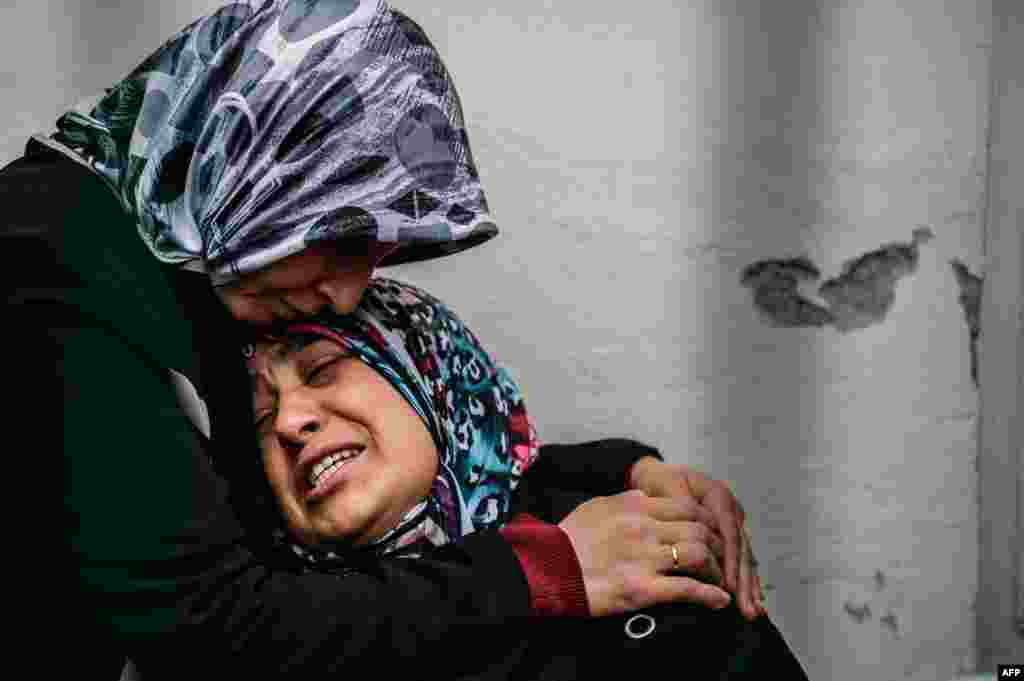 A mother of a victim cries as she waits for the body of her son at the forensic building in Ankara the day after a suicide car bomb ripped through a busy square in central Ankara killing 37 people and wounding 125, officials said.