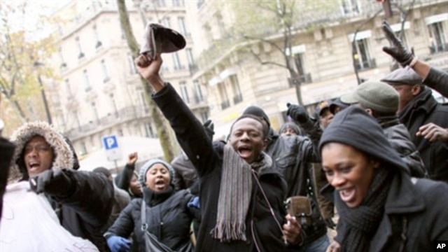 A man waves his cap during a demonstration in front of the Ivorian Embassy in Paris, 04 Dec 2010
