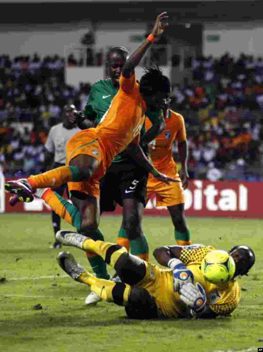 Ivory Coast's Gervinho (10) falls over Zambia's goalkeeper Kennedy Mweene (16) as he tries to score during their African Nations Cup final soccer match at the Stade De L'Amitie Stadium in Gabon's capital Libreville, February 12, 2012.