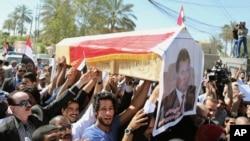 지난달 23일 이라크 바그다드에서 피살된 방송 기자 모함마드 브다이위의 추모행사가 열렸다. (자료사진)