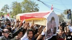 Tang lễ tượng trưng cho ký giả Mohammed Bdaiwi, người đứng đầu văn phòng phát thanh địa phương ở Baghdad bị bắn chết, ngày 23/3/2014.