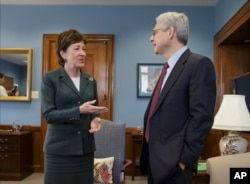 Judge Merrick Garland, right, President Barack Obama's choice to replace the late Justice Antonin Scalia on the Supreme Court, meets with Sen. Susan Collins, R-Maine, on Capitol Hill in Washington, April 5, 2016.