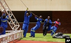 Workers erect stands ahead of Friday's presidential inauguration of Emmerson Mnangagwa, at the National Sports Stadium in Harare, Zimbabwe, Nov. 23, 2017.