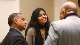 Indian diplomat Devyani Khobragade (C) and her father Uttam Khobragade (L) are seen after their meeting with India's Foreign Minister Salman Khurshid (not pictured) in New Delhi January 11, 2014.