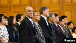 Thai Ambassador Virachai Plasai (L), Thai Minister of Foreign Affairs Kasit Piromya (2ndL), counsel Donald McRae (2nd R) and Mr Asda Jayanama (R) are seen in the courtroom in the dispute over the ownership of the Temple of Preah Vihear at the Internationa