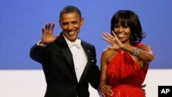 President Barack Obama and Michelle Obama wave to guests after their dance at the Inaugural Ball at the 57th Presidential Inauguration in Washington, Jan. 21, 2013.