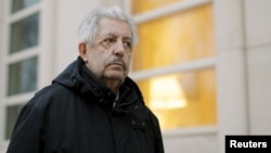 Former Venezuelan Football Federation president Rafael Esquivel exits the Brooklyn Federal Courthouse in New York, March 10, 2016. Esquivel pleaded guilty to seven counts of racketeering, money laundering conspiracies and wire fraud.