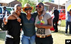 South African lesbians at a recent protest against killings of women involved in same-sex relationships