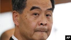 FILE - Leung Chun-ying at a press conference.